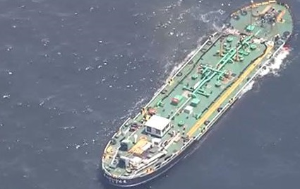 Two tankers collided off Japan, one partially sank; Oil leak reported