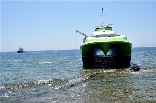 Hellenic's Seaways Flying Cat 4 ran aground in the shallow waters near Tinos, Greece