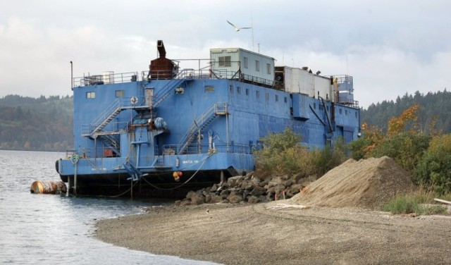 4,000-ton food-processing barge breaks free in windstorm, drifts across inlet