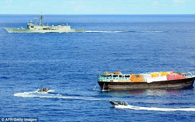 Boats, part of HMAS Darwin while boarding the pirate dhow with hidden heroin on board worth $132 million.