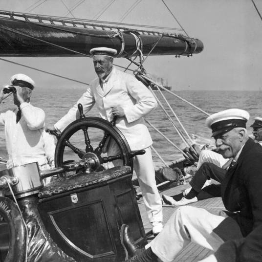 1924: King George V at the helm of the yacht Britannia