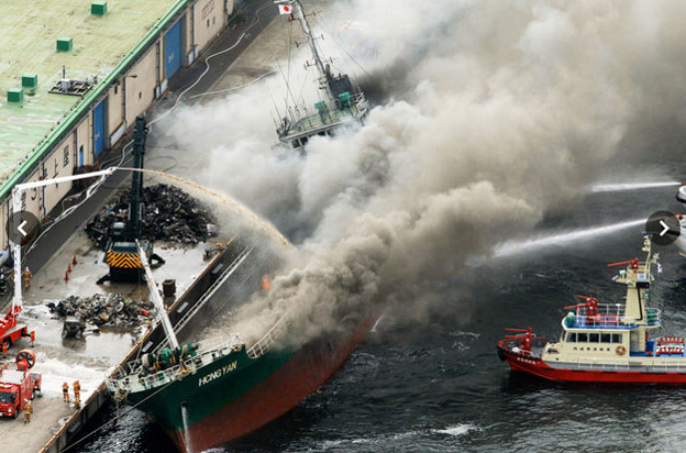 Fire on Freighter loaded with scrap in Kawasaki port, Japan