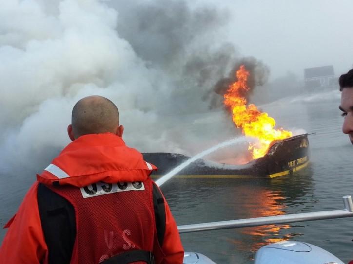 U.S. Coast Guard fights boat fire in Jonesport, Maine