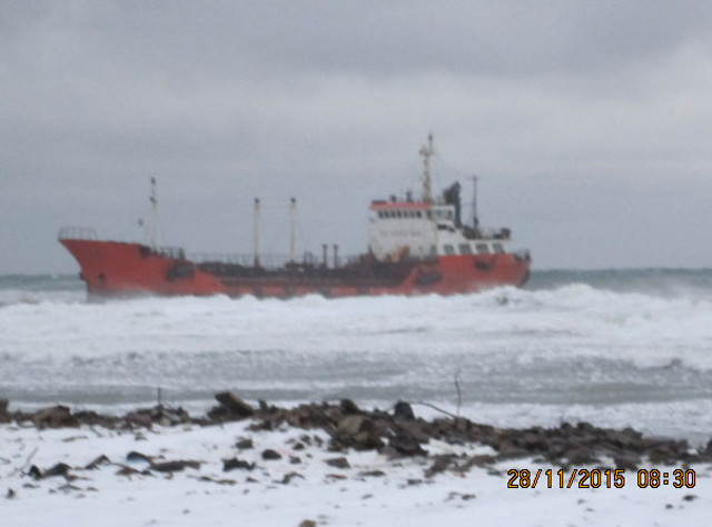 Tanker Nadezhda ran aground in a storm off Sakhalin Island, Russia; Ship's hull breached