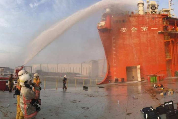 Seven hour operation to put out fire on cargo barge at Tuas shipyard, Singapore; Firefighter injured
