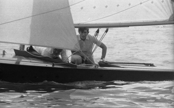 Prince Charles accompanied by Geoffrey Budden, a local schoolmaster, sailing Prince Philip's Flying Fifteen 'Coweslip' during the Royal London Yacht Club's regatta at Cowes