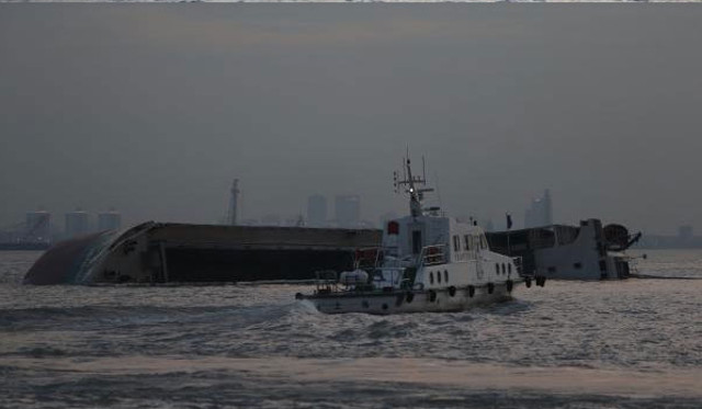 Freighter capsizes after collision with tanker carrying crude in Yangtze River