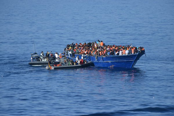 Men, women, children and two babies, many of them wearing life jackets, were massed onto the 20-metre (66-foot) long vessel - some perched on the edge - in an attempt to cross the Mediterranean and reach Europe.
