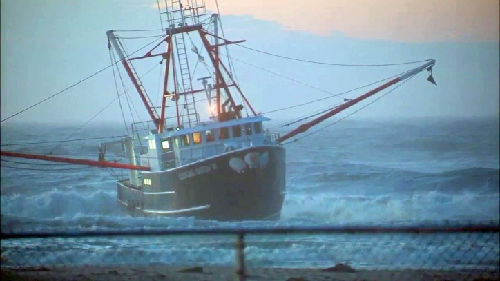Coast Guard vessel flips on way to fishing boat that ran aground off Queens; All safe (Video)