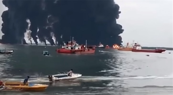Indonesia declares state of emergency around a port on Borneo island after oil spill (Video)