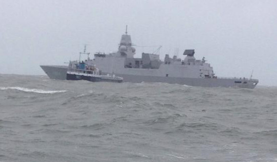 Dutch Frigate HNLMS De Ruyter arrives on scene at the request of the Coastguard to manage the tow of drifting cargo ship Verity off North Devon coast.