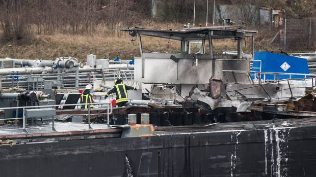 Firefighters on board a tanker which exploded in the Duisburg shipyard in western Germany