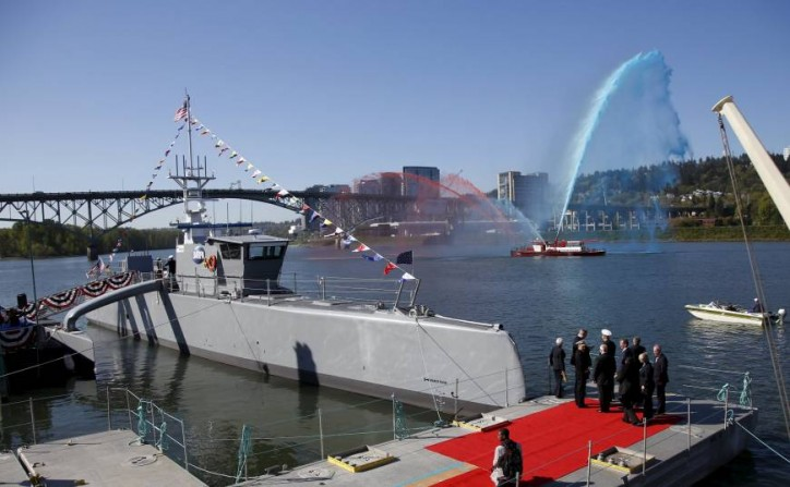 U.S. christens self-driving, sub-hunting warship to meet China, Russia threat, eyes Japan tests