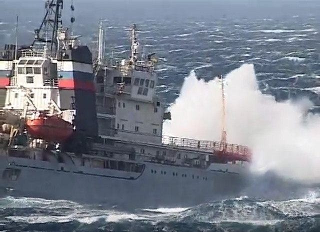 Heavy weather tugboat effort to take a Russian aircraft carrier under tow