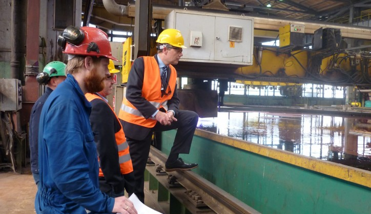 Steel cutting marks the production start of a shipbuilding project, here closely watched by Ulstein Verft and Color Line representatives.