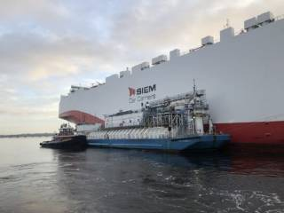 JAX LNG and TOTE Services conduct their first ship-to-ship LNG bunkering of a foreign-flagged vessel at JAXPORT