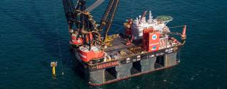 The world's largest semi-submersible crane vessel Sleipnir installs Dana Petroleum's P11-unity platform