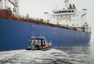 Pilot with sailing drone deployed for depth inspection of ships at IJmuiden' locks