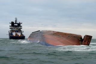 VIDEO: Capsized general cargo ship under tow in English Channel