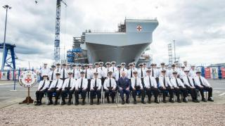 HRH Prince Charles places the final section of HMS Prince of Wales