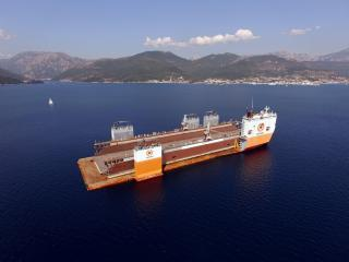 World's largest semi-submersible heavy-lift ship transports BLRT Grupp's floating dock from Montenegro to Lithuania
