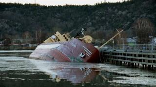 Self discharging bulk carrier Sterno sinking after running aground at Lilla Edet, Gota river, north of Gothenburg, Sweden