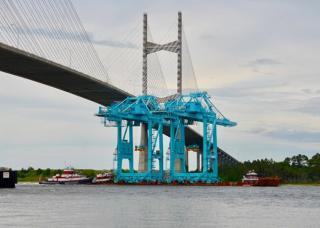 Large Jaxport container cranes move by barge up St. Johns River