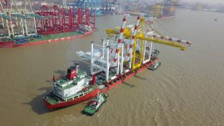 Four new ZPMC cranes leave China for DP World Australia
