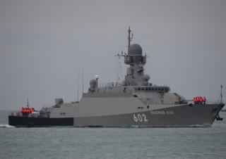 Russia sends new cruise missile ship to Syria, warns against U.S. intervention