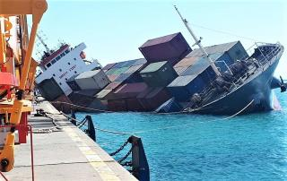 Careless loading of cargo containers sinks ship in Iran port (Video)