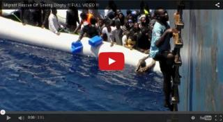 Video footage shows migrants rescued from deflating boat near Sicily