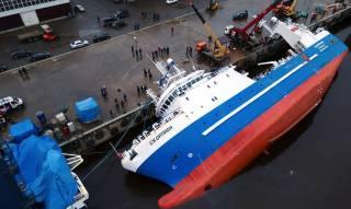WATCH: Fish factory ship under construction capsized, sank at shipyard, Russia
